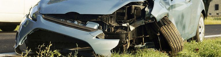 The smashed front end of a motor vehicle.