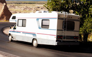 A recreational vehicle driving on the road